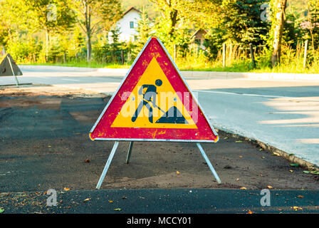 Works ahead warning sign on a road. - Stock Photo