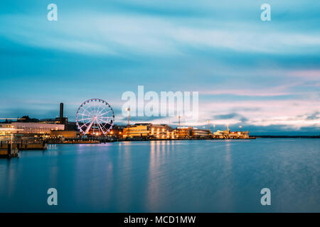 Helsinki, Finland - December 9, 2016: View Of Embankment With Ferris Wheel In Evening Night Illuminations. - Stock Photo