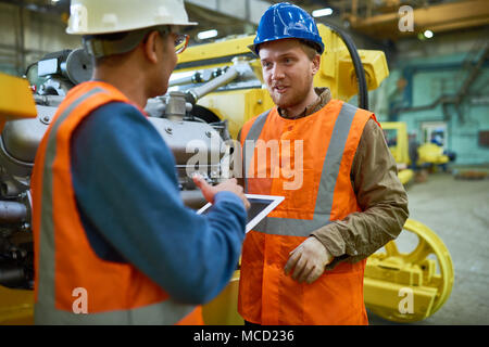 Solving Faced Problems with Colleague - Stock Photo