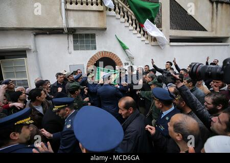 Algiers. 15th Apr, 2018. People attend the funeral of crashed military plane pilot Sadiki Mahrez in Algiers, Algeria, on April 15, 2018. A total of 257 people were killed on Wednesday morning in a military plane crash in Algeria's Blida Province, 30 km southwest of the capital Algiers. Credit: Xinhua/Alamy Live News - Stock Photo