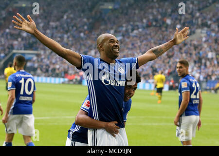 Gelsenkirchen, Germany. 15th Apr, 2018. Naldo (Front) of FC Schalke 04 celebrate after scoring during the Bundesliga match between FC Schalke 04 and Borussia Dortmund in Gelsenkirchen, Germany, on April 15, 2018. Credit: Joachim Bywaletz/Xinhua/Alamy Live News - Stock Photo
