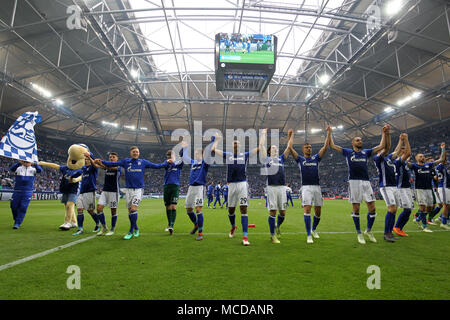 Gelsenkirchen, Germany. 15th Apr, 2018. Players of FC Schalke 04 celebrate after winning the Bundesliga match between FC Schalke 04 and Borussia Dortmund in Gelsenkirchen, Germany, on April 15, 2018. Credit: Joachim Bywaletz/Xinhua/Alamy Live News - Stock Photo