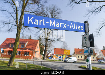 10 April 2018, Germany, Neuhardenberg: A street signe reads Karl-Marx-Allee. The town was previoulsy known as Marxwalde after German philosopher, economist and social theorist Karl Marx (May, 05 1818 - March, 14 1883) during the GDR era and renamed to Neuhardenberg after the fall of the Berlin Wall. Photo: Patrick Pleul/dpa-Zentralbild/dpa