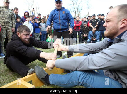 Russia. 15th Apr, 2018. CHECHNYA, RUSSIA - APRIL 15, 2018: People take part in the first Republican Cossack Games held by the Terek Cossacks community in the village of Novoshchedrinskaya, Shelkovskoi District. The Chechen Republic's Terek and Sunzha Cossack community comprises six Cossack communities in Naursky and Shelkovskoi Districts. Yelena Afonina/TASS Credit: ITAR-TASS News Agency/Alamy Live News - Stock Photo