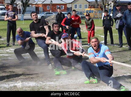 Russia. 15th Apr, 2018. CHECHNYA, RUSSIA - APRIL 15, 2018: Men compete in a tug of war contest as part of the first Republican Cossack Games held by the Terek Cossacks community in the village of Novoshchedrinskaya, Shelkovskoi District. The Chechen Republic's Terek and Sunzha Cossack community comprises six Cossack communities in Naursky and Shelkovskoi Districts. Yelena Afonina/TASS Credit: ITAR-TASS News Agency/Alamy Live News - Stock Photo