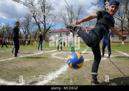 Russia. 15th Apr, 2018. CHECHNYA, RUSSIA - APRIL 15, 2018: Men play volleyball as part of the first Republican Cossack Games held by the Terek Cossacks community in the village of Novoshchedrinskaya, Shelkovskoi District. The Chechen Republic's Terek and Sunzha Cossack community comprises six Cossack communities in Naursky and Shelkovskoi Districts. Yelena Afonina/TASS Credit: ITAR-TASS News Agency/Alamy Live News - Stock Photo