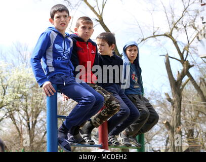 Russia. 15th Apr, 2018. CHECHNYA, RUSSIA - APRIL 15, 2018: Boys watch the first Republican Cossack Games held by the Terek Cossacks community in the village of Novoshchedrinskaya, Shelkovskoi District. The Chechen Republic's Terek and Sunzha Cossack community comprises six Cossack communities in Naursky and Shelkovskoi Districts. Yelena Afonina/TASS Credit: ITAR-TASS News Agency/Alamy Live News - Stock Photo