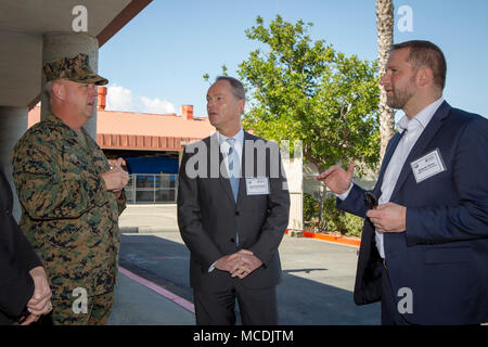 Brigadier General Kevin J. Killea, Commanding General, Marine Corps Installations West (L) and Bernhard Kuhnt, president & CEO BMW of North America. BMW of North America is working with the Marine Corps in a first-of-its-kind partnership to open an automotive technician training center on a U.S. military base. Service members at Camp Pendleton, near San Diego, CA., will train for highly technical jobs as they transition to civilian life in the MSTEP (Military Service Technician Education Program). (Courtesy photo by David Poller) - Stock Photo