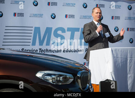 Bernhard Kuhnt, president & CEO of BMW North America, addresses the crowd at the official opening of the BMW MSTEP (Military Service Technician Education Program) center aboard Camp Pendleton on Thursday. BMW of North America is working with the  Marine Corps in a first-of-its-kind partnership to open an automotive technician training center on a U.S. military base. Service members at Camp Pendleton, near San Diego, CA., will train for highly technical jobs as they transition to civilian life in the MSTEP. (Courtesy Photo by David Poller) - Stock Photo