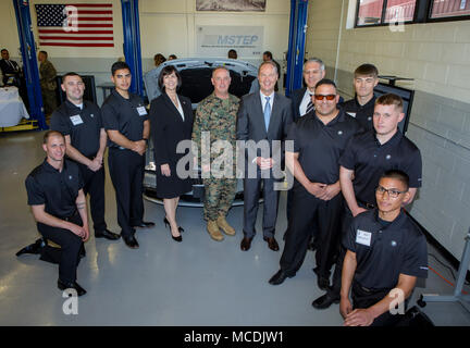 Bernhard Kuhnt, president and CEO of BMW North America, Brigadier General Kevin J. Killea, Commanding General, Marine Corps Installations West, and Kim McWaters, CEO of Universal Technical Institute pose with members of the inaugural class of MSTEP student technicians at the official opening of the BMW MSTEP (Military Service Technician Education Program) center aboard Camp Pendleton on Thursday. BMW of North America is working with the Marine Corps in a first-of-its-kind partnership to open an automotive technician training center on a U.S. military base. Service members at Camp Pendleton, ne - Stock Photo
