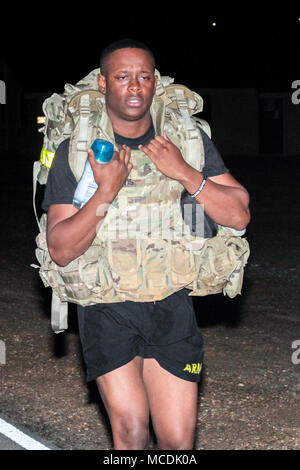 Mississippi Army National Guard Sgt. Rodrecus M. Lewis, an information technology specialist assigned to Headquarters Company, 155th Armored Brigade Combat Team, takes part in a ruck march for physical training at Camp Shelby Joint Forces Training Center, Miss., Feb 20th 2018. The 155 ABCT is preparing for an upcoming for an upcoming deployment to the Middle East in support of Operation Spartan Shield. (U.S. Army National Guard photo by Spc. Jovi Prevot) - Stock Photo