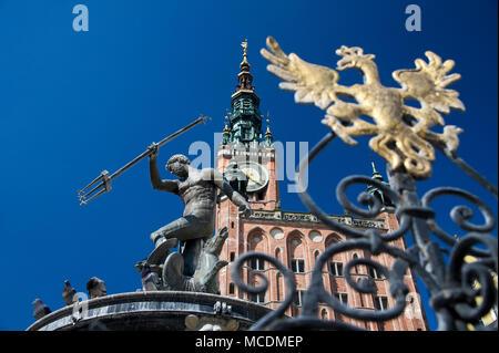 Flemish mannerist Fontanna Neptuna (Neptune's Fountain) and Gothic Ratusz Glownego Miasta (Gdansk Main Town Hall) on Dlugi Targ (Long Market) in Main  - Stock Photo