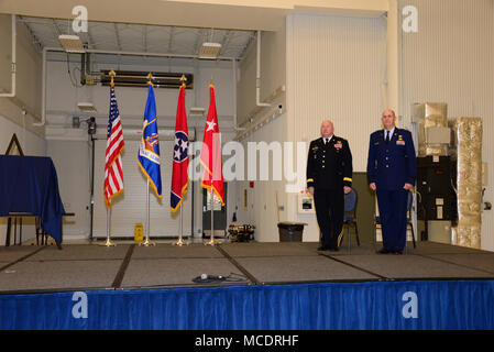 Maj. Gen. Max Haston, Adjutant Gen., Tenn. (Army) and Brig. Gen. Donald Johnson, Assistant Adjutant Gen., Tenn. (Air) stand at attention during the retirement for Brig. Gen. Johnson on March 10 at McGhee Tyson ANG Base.  Brig. Gen. Johnson started his career at McGhee Tyson ANG Base and stated that he wanted to close his career where it begain and where he describes as 'home'. - Stock Photo
