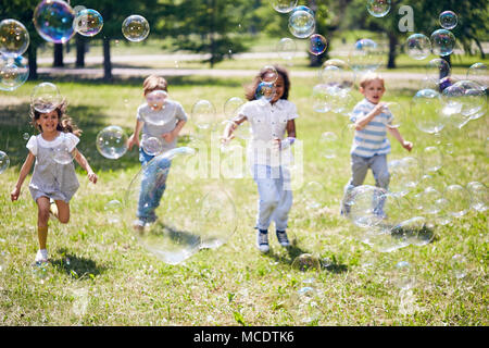 Wrapped up in Catching Soap Bubbles - Stock Photo