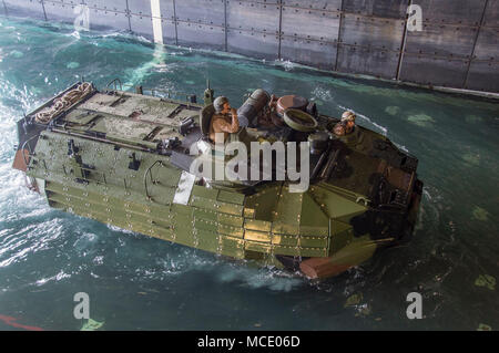 180227-N-DC385-200 GULF OF THAILAND (Feb. 27, 2018) An amphibious assault vehicle (AAV), assigned to the 3rd Assault Amphibian Battalion, 3d Marine Division (MARDIV), enters the well deck of the amphibious assault ship USS Bonhomme Richard (LHD 6). Bonhomme Richard is operating in the Indo-Pacific region as part of a regularly scheduled patrol and provides a rapid-response capability in the event of regional contingency or natural disaster. (U.S. Navy photo by Mass Communication Specialist 3rd Class Cosmo Walrath/Released) - Stock Photo