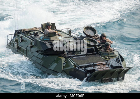 180227-N-DC385-211 GULF OF THAILAND (Feb. 27, 2018) An amphibious assault vehicle (AAV), assigned to the 3rd Assault Amphibian Battalion, 3d Marine Division (MARDIV), approaches the well deck of the amphibious assault ship USS Bonhomme Richard (LHD 6). Bonhomme Richard is operating in the Indo-Pacific region as part of a regularly scheduled patrol and provides a rapid-response capability in the event of regional contingency or natural disaster. (U.S. Navy photo by Mass Communication Specialist 3rd Class Cosmo Walrath/Released) - Stock Photo