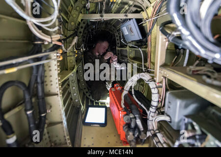 Senior Airman Kaiden Stanley, 723d Aircraft Maintenance Squadron integrated flight control systems specialist, performs maintenance while inside the transition section of an HH-60G Pavehawk, Feb. 27, 2018, at Moody Air Force Base, Ga. They were evaluated on their ability to unfold the tail and main rotors of a Pavehawk to practice making the helicopter operational in a limited amount of time. (U.S. Air Force photo by Airman Eugene Oliver) - Stock Photo