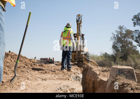 Repair work begins on a 2 1/4 mile section of Border Fence in El Centro Sector near the Calexico West Port of Entry.    Photos by Mani Albrecht  U.S. Customs and Border Protection  Office of Public Affairs  Visual Communications Division - Stock Photo