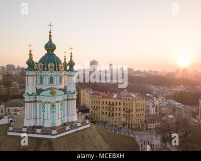 Aerial top view of Saint Andrew's church and Andreevska street, cityscape of Podol district city of Kiev , Ukraine. Drone photo - Stock Photo