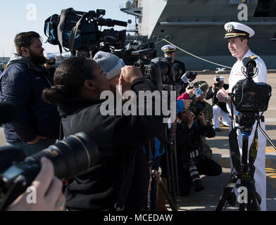 180411-N-GY005-031 NORFOLK, Va. (Apr. 11, 2018) USS Harry S. Truman (CVN 75) Commanding Officer, Capt. Nicholas Dienna speaks to the media on the pier prior to the ship getting underway for deployment. Truman is currently moored at Naval Station Norfolk preparing for deployment. (U.S. Navy photo by Mass Communication Specialist 3rd Class Gitte Schirrmacher) - Stock Photo