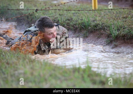 U.S. Army Ranger 1st Lt. Joseph Royster, assigned to the 3rd U.S. Infantry Regiment (Old Guard), low crawls during the Best Ranger Competition at Fort Benning, Ga, April 12, 2018. The 35th Annual David E. Grange Jr. Best Ranger Competition 2018 is a three-day event consisting of challenges to test competitors' physical, mental, and technical capabilities. (U.S. Army photo by Spc. Tarako Braswell) - Stock Photo