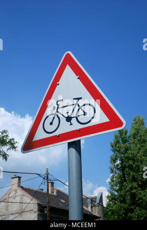 Triangular sign warning of a cycle route ahead, Budapest, Hungary - Stock Photo