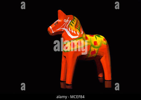 Swedish Dalecarlian horse or Dala horse is a traditional painted wooden statuette - Stock Photo