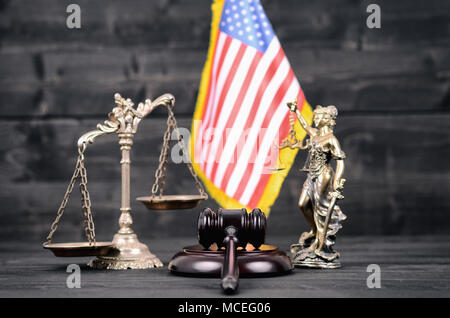 Law and Justice , Legality concept, Judge Gavel, Lady Justice, Scales of Justice and USA flag on a black wooden background. - Stock Photo