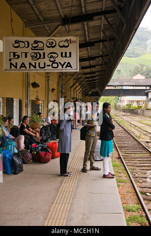 Vertical view of people waiting at Nanu-oya Train Station in the highlands of Sri Lanka. - Stock Photo