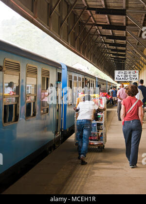 Vertical view of people at Nanu-oya Train Station in the highlands of Sri Lanka. - Stock Photo