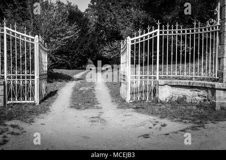 View of opened gate leading to a farm, Brittany, France, Europe - Stock Photo