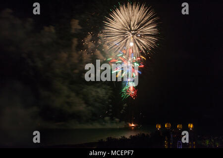Fireworks over the sky at fourth of July celebration. - Stock Photo