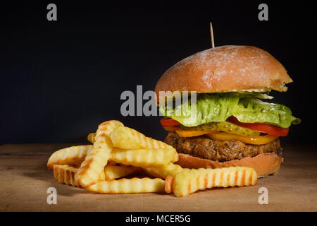 Burger & Fries with dark background space - Stock Photo
