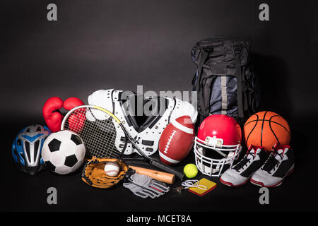 Close-up Of Various Sport Equipments Isolated On Black Background - Stock Photo