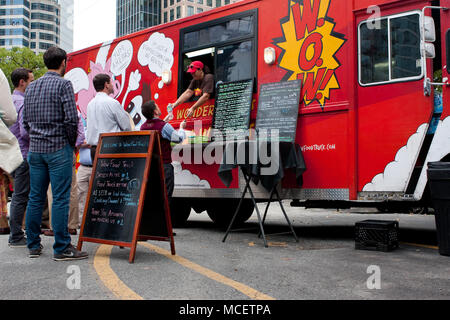Customers wait in line to order meals from a popular food truck during their lunch hour, at 'Food Truck Thursday' on October 16, 2014 in Atlanta, GA. - Stock Photo