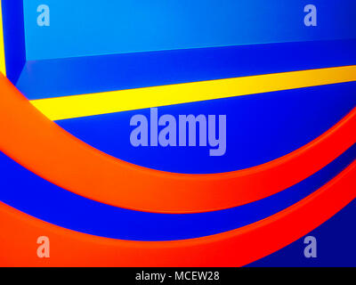 Close up of a child's play area painted in bright bold colors - Stock Photo