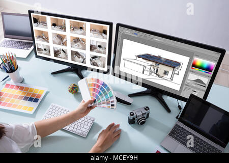 High Angle View Of A Female Designer Working On Color Selection For House - Stock Photo