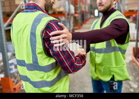 Two Workers in Warehouse - Stock Photo