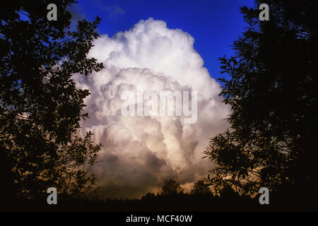 grey black cloud in a blue sky - Stock Photo