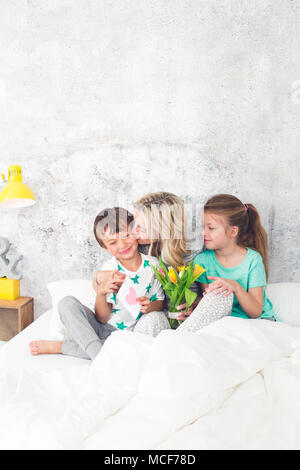 Happy Family - Children congratulate on Mother's Day - Stock Photo