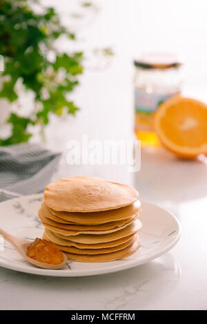 Cooking for breakfast. Delicious homemade pancakes on a plate - Stock Photo