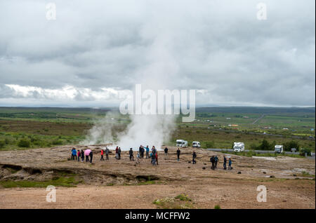 Haukadalur Valley, Iceland - July, 19, 2017:  View of a Meadow with Steaming Hot Springs, Haukadalur Valley, Southern Iceland - Stock Photo
