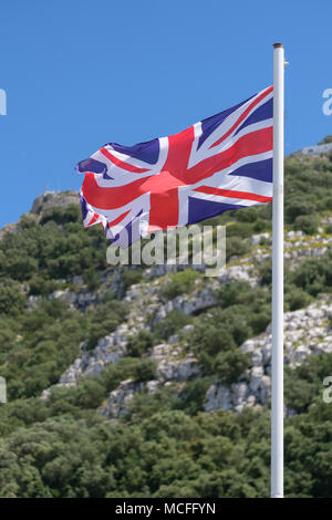 Union Jack Flag blowing in the wind. - Stock Photo