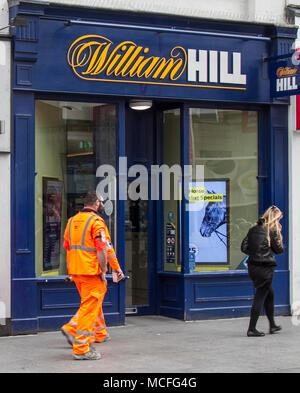 People passing William Hill bookmakers in Liverpool, Merseyside, UK - Stock Photo