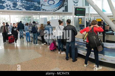 Passengers waiting for luggage on airport - Stock Photo
