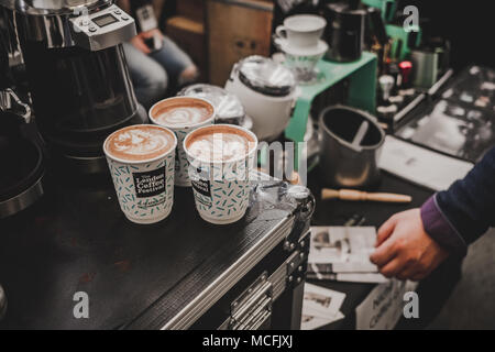 Latte art in filled cups at the London Coffee Festival – April 2018 - Stock Photo