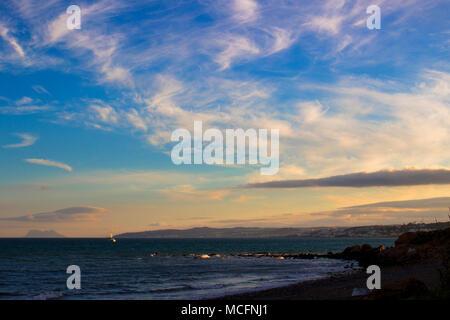 Beach. Sunset on a stone beach in Estepona. - Stock Photo