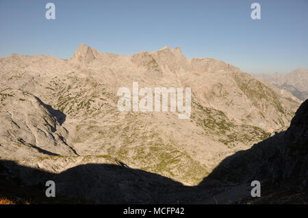view at desertlike Steinernes Meer mountain range with Funtenseetauern at Berchtesgaden national park between Austria and Germany - Stock Photo