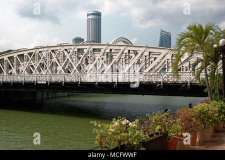 The Anderson Bridge over the Singapore river with Stamford hotel and South Beach in the background, part of the Singapore F1 track - Stock Photo