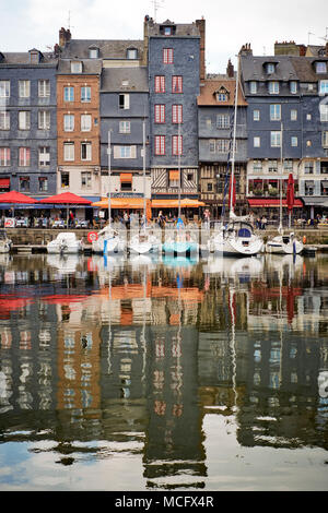 Honfleur is a city in the department of Calvados, in northern France's Normandy region. It's on the estuary where the Seine river meets the Channel. - Stock Photo